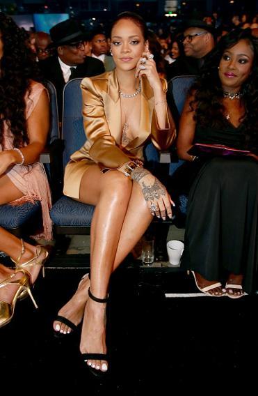 Rihanna in a gold tuxedo.