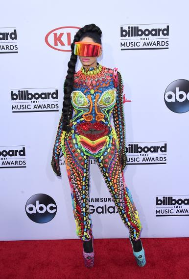 Dencia wears a few colors at the 2015 Billboard Music Awards.