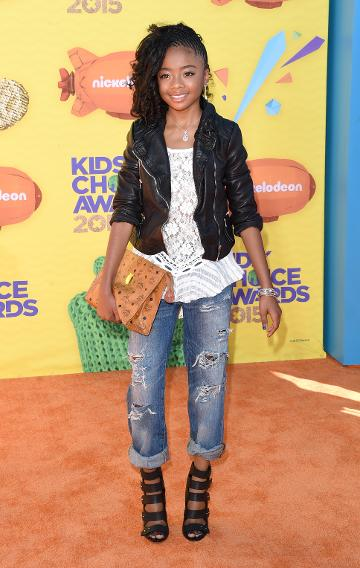 Skai Jackson in a leather jacket and ripped jeans
