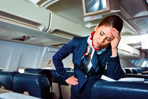 12 Surprising Things a Flight Attendant Can't Do for You (So Stop Asking)