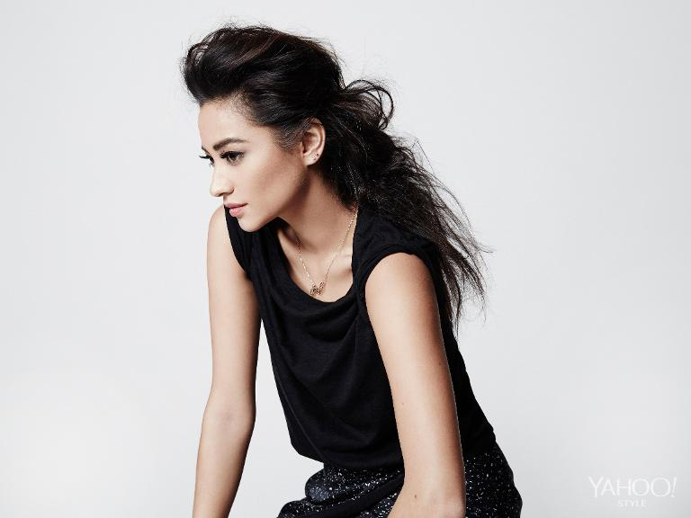 Shay Mitchell sporting a Vince leather-lined tee and a Nanushka black skirt.
