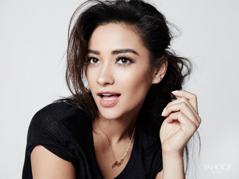 Shay Mitchell wearing a simple  black Vince tee shirt.