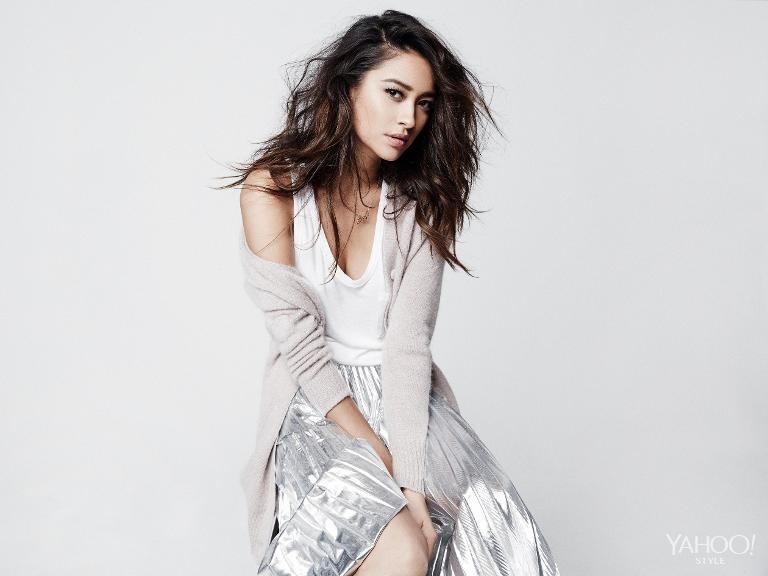 Shay Mitchell in a Band of Outsiders cardigan, simple tank by Alexander Wang, & a silver DKNY pleated skirt.