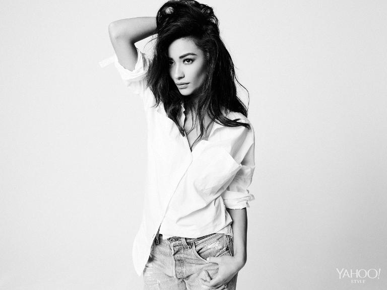 Shay Mitchell in a Jonathan Simkhai top paired with Levi's jeans.