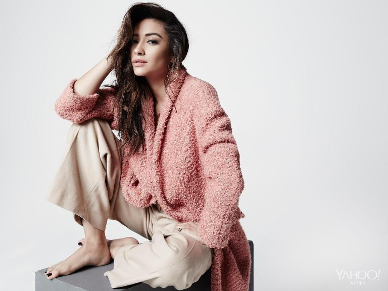 Shay Mitchell in an Isabel Marant pink coat and khaki Edun pants.