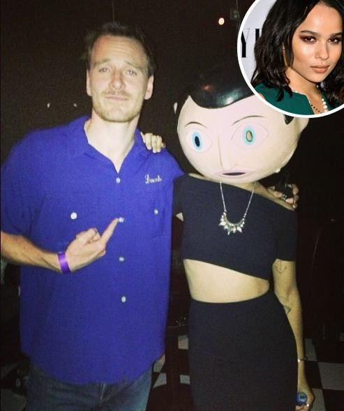 Who Is That Masked Stranger Standing Next to Michael Fassbender?