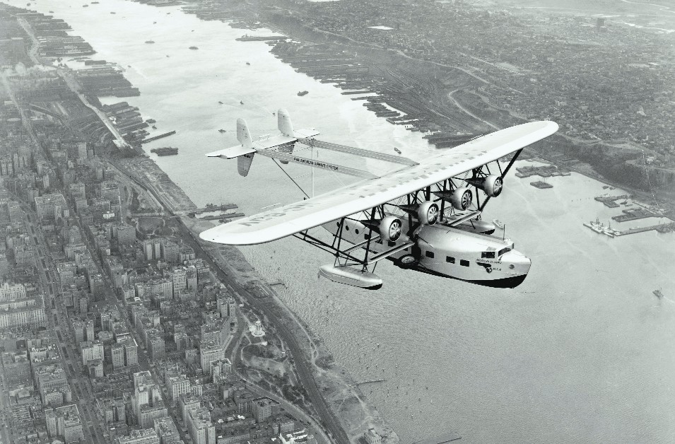 Sikorsky, Pan Am's flying boat, soaring over Manhattan, 1931.