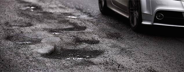 Car drives by potholes (Sky)