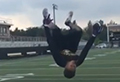 High school student catches ball while doing backflip