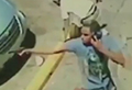 WATCH: Man takes a call while shooting at people