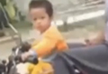 Toddler drives a motorcycle