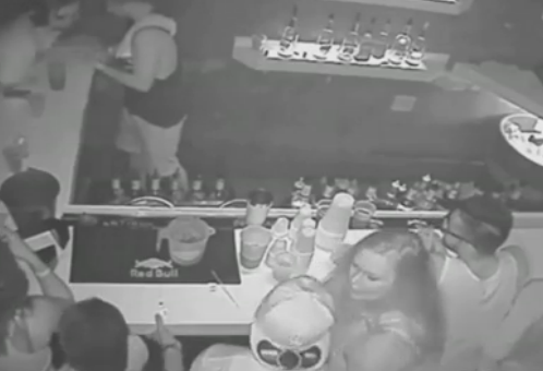 CCTV: Football star punches woman in bar