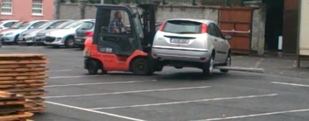Workers deal with 'in the way' parked car (Newsflare)