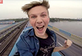 WATCH: Teen's epic ride atop train