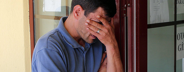 Abdullah Kurdi, 40, father of Syrian boys Aylan, 3, and Galip, 5, who were washed up drowned on a beach near Turkish resort of Bodrum on Wednesday, waits for the delivery of their bodies outside a morgue in Mugla, Turkey, Thursday, Sept. 3, 2015. Images of Aylan's body on the beach, have heightened global attention to a wave of migration, driven by war and deprivation, that is unparalleled since World War II. (Tolga Adanali/Depo Photos via AP)