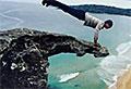 Actor Kellan Lutz performs daring cliff workout