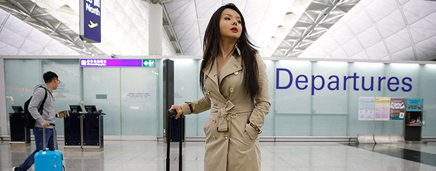 Canada's Miss World contestant Anastasia Lin poses for photographers after she was denied entry to mainland China, at Hong Kong International Airport in Hong Kong, Thursday, Nov. 26, 2015. Miss World Canada was barred from entering China on Thursday to take part in this year's pageant in the southern island province of Hainan, a friend of the outspoken Chinese-Canadian contestant said. Lin was prevented from boarding her connecting flight in Hong Kong, Caylan Ford said in an email. She said authorities gave no reason. (AP Photo/Kin Cheung)