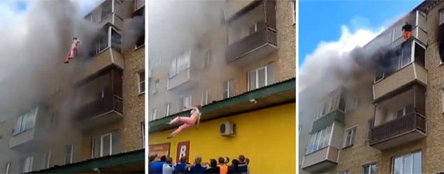 Family jump to escape burning building