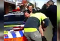 WATCH: Tradies help out policeman being attacked