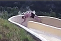 VIDEO: Man goes flying over the edge of waterslide