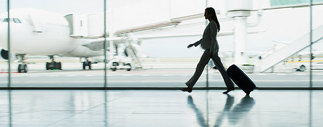 Woman walking at an airport (Getty)