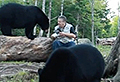 VIDEO: Fearless photographer bonds with bears