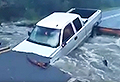 VIDEO: Truck gets stuck as road is washed away