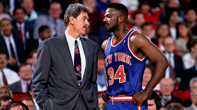 Jackson then coach of the Chicago Bulls and Oakley catch up during a game in 1991. Pic Getty