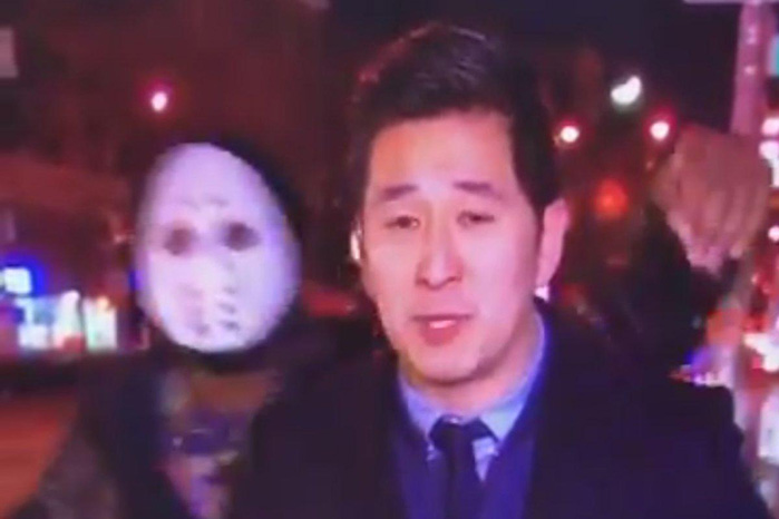 Creep in hockey mask shoves reporter during live broadcast