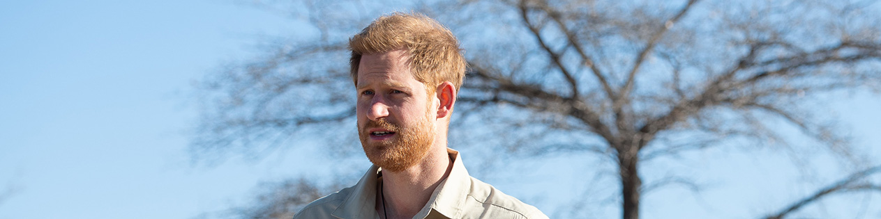 Prince Harry, Duke of Sussex walks through a minefield during a visit to see the work of landmine clearance charity the Halo Trust