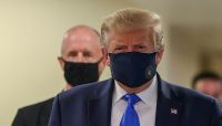 Trump shifts rhetoric as he urges mask-wearing, warns of worsening pandemic