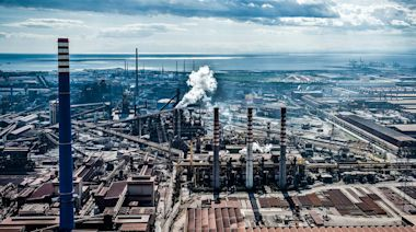 Fresh air can combat COVID-19. For Italy's most polluted town, in the shadow of a steel mill, opening the windows is not an option.