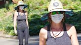 Lisa Rinna shields herself from sun during braless walk in Studio City