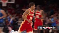Trae Young with a half court shot vs the Milwaukee Bucks
