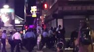 Police Rush Crowd on Sidewalk During Second Night of Protests Over Police Shooting of Walter Wallace Jr.