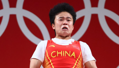 Chinese embassy blasts 'ugly' Reuters for using 'shameless' photo of gold medalist