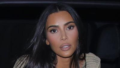 Kim Kardashian Debuts Her Billionaire Style in a Peek-a-Boo Cutout Top, High-Rise Jeans & Soft Booties