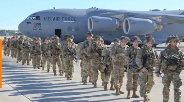 Iran warns U.S. over Iraq deployment amid virus
