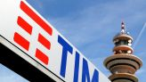 Telecom Italia slides to one-year low after cutting guidance