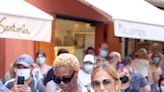 Jennifer Lopez Wore a White Sundress with Ab-Baring Cutouts