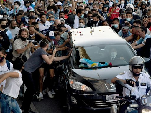 Argentine football legend Diego Maradona laid to rest as tributes continue to pour in
