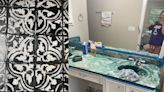 Meet the overnight TikTok sensation - 23-year-old 'Picasso of the DIY world' - whose followers are begging for an end to her viral disaster bathroom renovation
