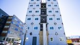 Shipping container apartments' opening delayed by global shortages, developer says