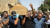 Killing of Iraq expert stirs fear of new violent phase