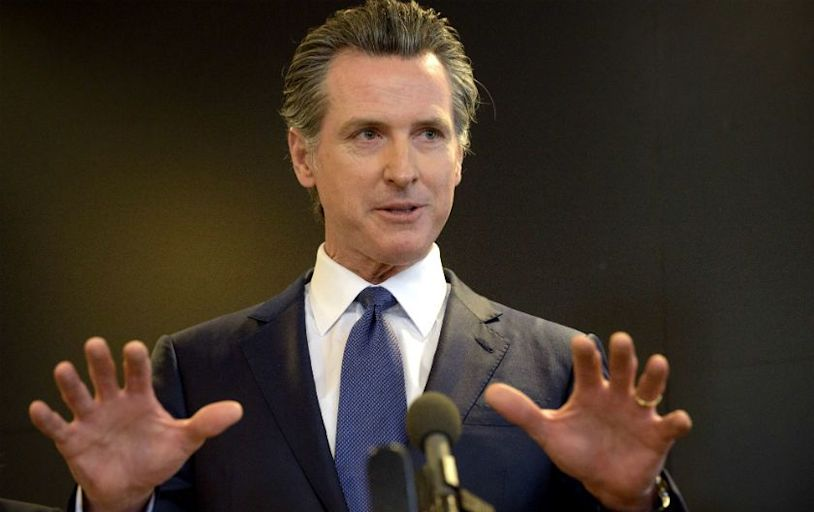 A champion of COVID-19 vaccines, Newsom fights plan to mandate them for prison guards