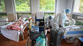"""Doctors """"desperate"""" for people to get COVID shots as Romanian hospitals reach """"the limit"""""""
