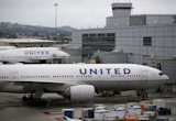 Two United Airlines pilots arrested on suspicion of being too drunk to fly from Glasgow to New York