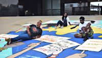 'Good Trouble': Local artists paint mural honoring Congressman John Lewis and Justice Ruth Bader Ginsburg at SPLC headquarters