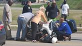 Milwaukee police officer injured after losing control, getting trapped under motorcycle