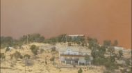 Orange Haze Looms Over Homes in Lincoln County as Three Rivers Fire Spreads
